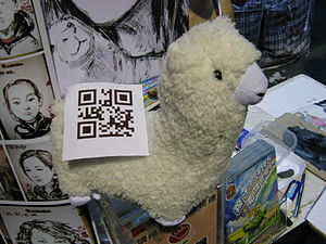 An Alpaca doll with a QR code