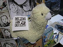 An Alpaca doll with a QR code